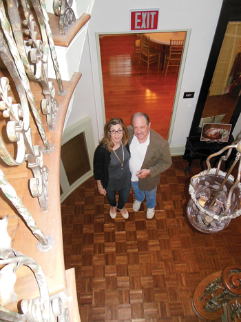 MIKE REUTHER/Sun-Gazette Charlie and Carmen Bush pose inside Bush House, which following extensive renovations is available for banquets, weddings and other events. The venue also sports an Italian marble fireplace, conference room, banquet rooms and tea house.