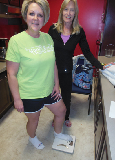 MIKE REUTHER/Sun-Gazette  Kelli Smith, left, is shown with Rose Trevouledes, a registered dietitian and nutritionist, prior to a yoga session at Muncy Bank & Trust. More than a dozen bank employees are taking part in the six week wellness plan.