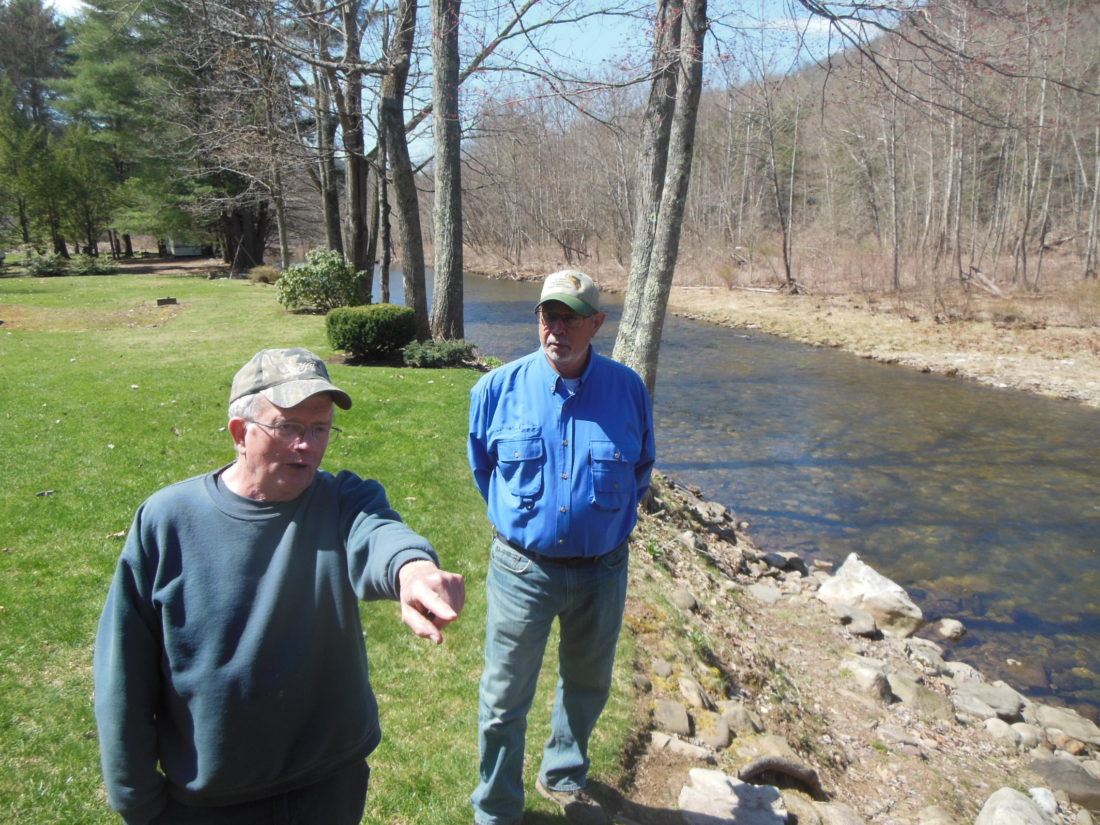 MIKE REUTHER/Sun-Gazette Top, Jack Walsh points out a spot on Loyalsock Creek to Steve Szoke.