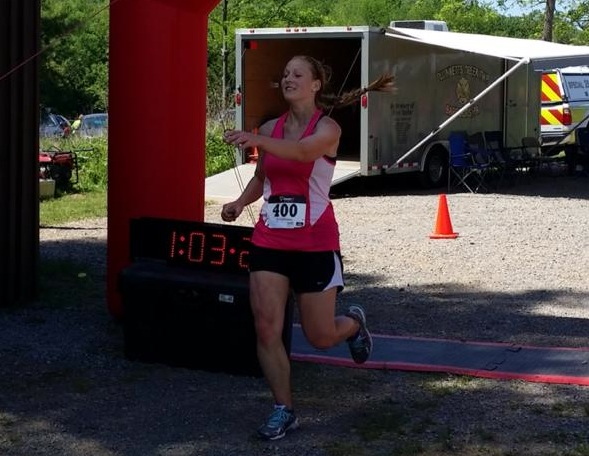 Montoursville athletic director Evelyn Wynn crosses the finish line of the Rider Rattler 10K race at Rider Park in 2014. Wynn will be running in the New York City Marathon for charity.