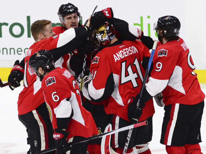 Ottawa Senators players celebrate their victory over the New York Rangers with goalie Craig Anderson (41) during the first overtime period in game five of a second-round NHL hockey Stanley Cup playoff series in Ottawa on Saturday, May 6, 2017. THE CANADIAN PRESS/Sean Kilpatrick