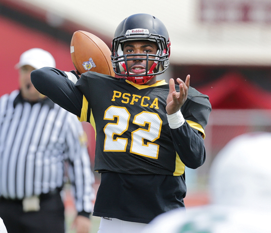 EDLEE/For the Sun-Gazette Quarterback Isaiah Hankins, of Williamsport, looks to throw downfield during the East-West All-Star football game at Mansion Park in Altoona on Sunday.