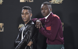 "Jharrel Jerome, left, and Ashton Sanders, winners of the award for best kiss for ""Moonlight"", pose in the press room at the MTV Movie and TV Awards at the Shrine Auditorium on Sunday, May 7, 2017, in Los Angeles. (Photo by Richard Shotwell/Invision/AP)"