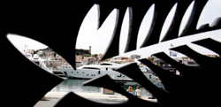 FILE - In this Tuesday, May 10, 2011, file photo, a yacht is seen behind a logo for the 64th international film festival, in Cannes, southern France. After a backlash over programming Netflix films, the Cannes Film Festival said it will, beginning next year, only accept theatrically released films for its prestigious Palme dÕOr competition. In a statement Wednesday, May 10, 2017, the French festival said it has adapted its rule to require films in competition to be distributed in French movie theaters. (AP Photo/Virginia Mayo, File)