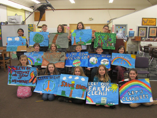 PHOTO PROVIDED West Branch School students display the posters they made during an Earth Day event held last month.