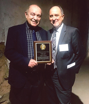 PHOTO PROVIDED Eugene Breisch, left, receives the Pennsylvania Prison Society Official Visitor of the Year award.
