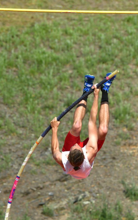 MARK NANCE/Sun-Gazette Connor Schramm of Williamsport clears 13-9 to win the Class AAA boys pole vault title Thursday at Williamsport.