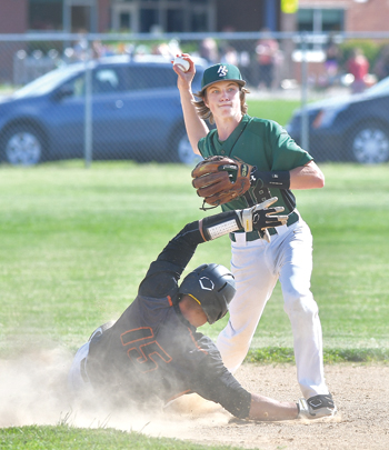 MARK NANCE/Sun-Gazette Hughesville's Mike Hill looks to turn a double play as Jersey Shore's Lance Welsh slides into second base during Friday's game. Both teams begin the District 4 playoffs this week.