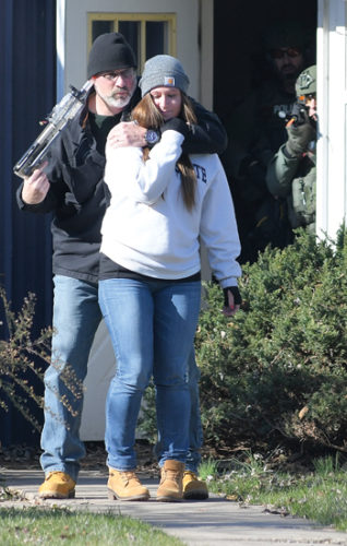 SUN-GAZETTE FILE PHOTO A man portraying a gunman holds a hostage at gunpoint as he leaves the building while being watched by a member of the Lycoming County Special Response Team during a drill by the hostage negotiation team at the former Bayard Plant in Old Lycoming Township in this Nov. 23, 2016, photo.