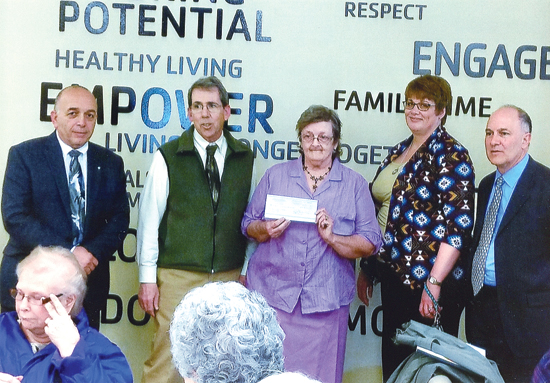 PHOTO PROVIDED County commissioners Tony Mussare, Jack McKernan and Rick Mirabito and county controller Krista Rogers, presented a check to Mary Lee Harris, president of Lycoming County Senior Citizens for $10,000 to be used by all the chapters of senior citizens in the county.