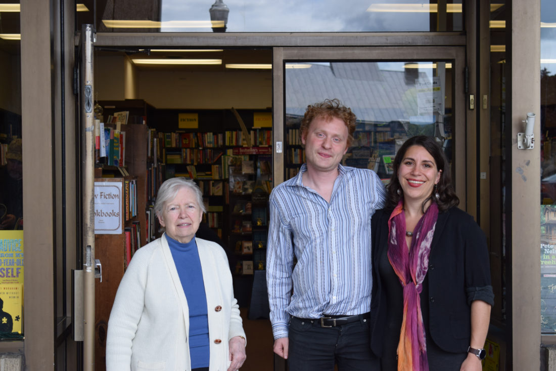 IOANNIS PASHAKIS/Sun-Gazette  Kathryn Nassberg and Isak Sidenbladh stand with the previous owner of Otto's bookstore, Betsy Rider after the store on Friday.