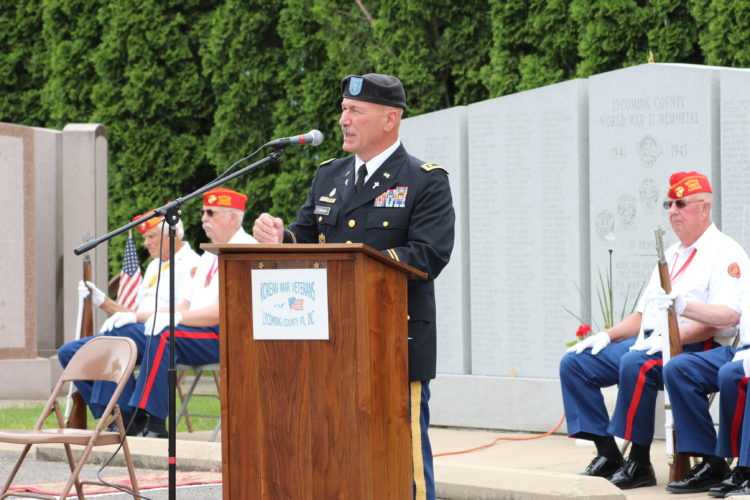 CARA MORNINGSTAR/Sun-Gazette Maj. Max Furman, a chaplain in the U.S. Army, speaks during the annual Memorial Day Service at Veterans Memorial Park in Williamsport on Saturday.