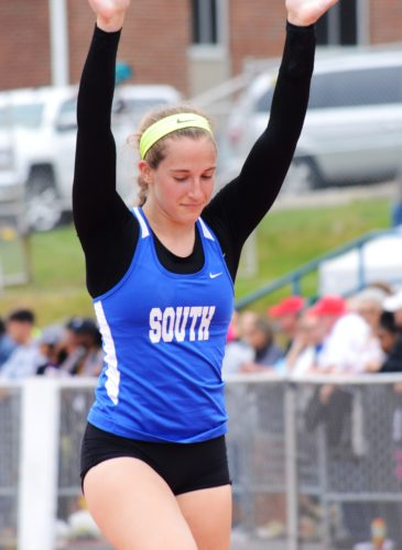 BRIAN FEES/For The Sun-Gazette Katie Jones of South Williamsport waves to the crowd after clearing 13-4 to win the Class AAgirls pole vault Saturday at Shippensburg.