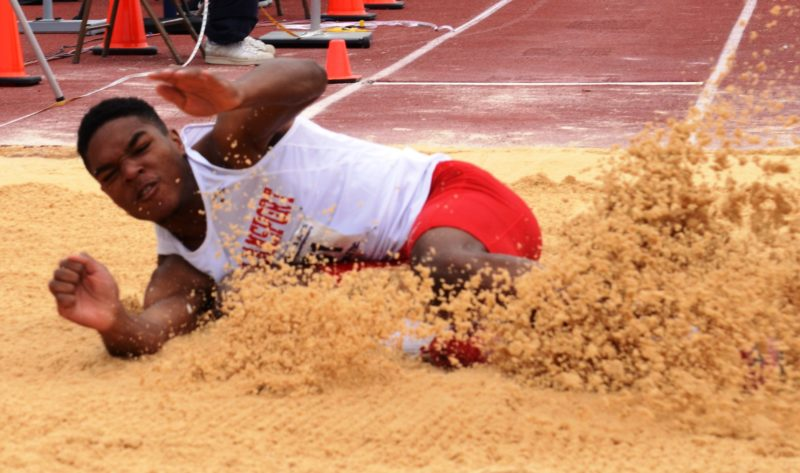 BRIAN FEES/For The Sun-Gazette Qayyim Ali of Williamsport lands in the long jump Saturday.