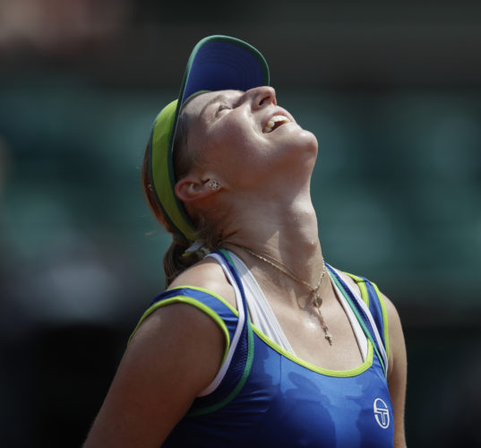 Russia's Ekaterina Makarova celebrates winning in two sets 6-2, 6-2, against Germany's Angelique Kerber at the French Open at the Roland Garros stadium in Paris, France, on Sunday. Kerber is the first women's No. 1 seed to lose in the French Open's first round in the Open era. (AP)