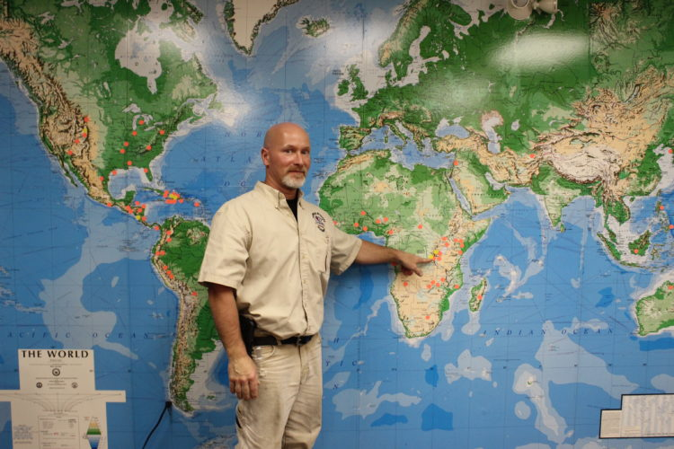 CARA MORNINGSTAR/Sun-Gazette Michael Fisher, solar contractor with I-TEC, points to a new location in Africa where the team plans to set up a power pack this summer. The rest of the map shows the locations where I-TEC has made trips in 40 countries.
