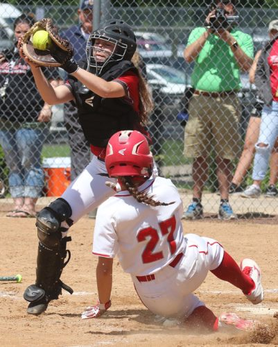 Warren Ruda/The Citizens' Voice Williamsport catcher Kalindi Maggs takes the relay as Hazleton's Taylor Kaschak slides safely across home Thursday at Wilkes University in the District 2-4 Class AAAAAA softball final.