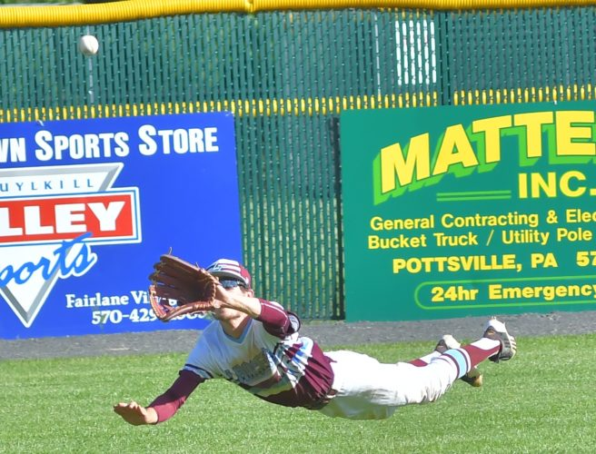 MARK NANCE/Sun-Gazette Loyalsock left fielder Larry Van Stavoren (16) dives for a catch in the sixth inning Thursday in the PIAA Class AAA baseball second round at Pottsville.