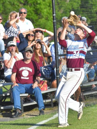MARK NANCE/Sun-Gazette Loyalsock third baseman Ryan Fink chases down a foul ball for the final out under the watchful eyes of Loyalsock fans in the bottom of the seventh inning Thursday at Pottsville.
