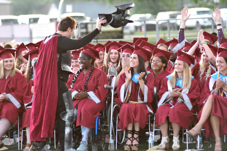 "MARK NANCE/Sun-Gazette Former social studies teacher Elijah McNaughton surprises the Loyalsock Township graduates by delivering their school's ""first diploma."""