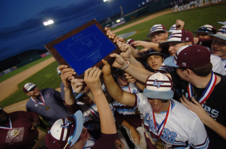 Loyalsock players celebrate their District 4 Class AAA championship after defeating Central Columbia at Penn State's Medlar Field  this year. The faces change on the field, and there's a new head coach, but the tradition at Loyalsock continues. (MARK NANCE/Sun-Gazette)
