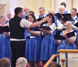 MARK NANCE/Sun-Gazette     Michael Connor directs Williamsport's Gesang Verein Harmonia choir in the United Singers Federation of Pennsylvania's 85th Sangerfest at Messiah Lutheran Church in South Williamsport Saturday. The group is celebrating its 125th anniversary.