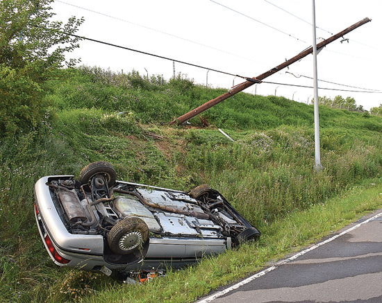 IOANNIS PASHAKIS/Sun-Gazette An unidentified man suffered minor injuries, police said, when his car hit an embankment and flipped on Route 220 Monday evening.