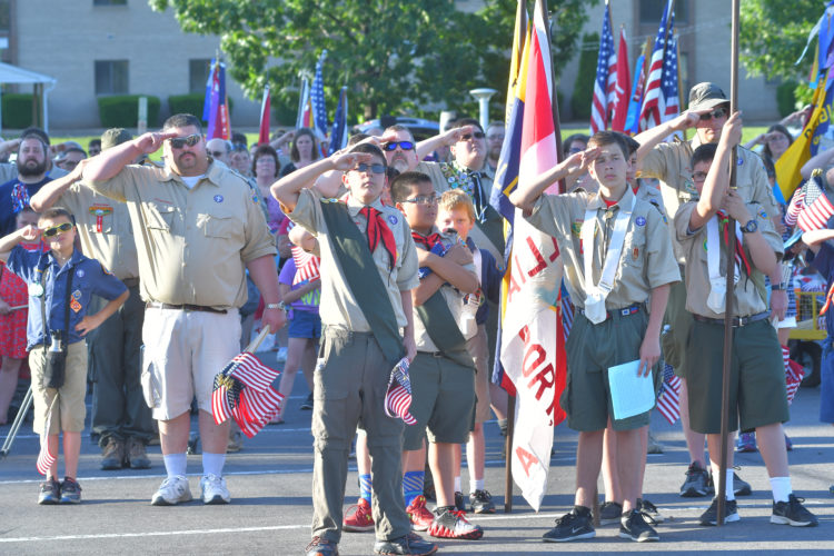 MARK NANCE/Sun-Gazette       Boy Scouts salute the flag during the playing of the National Anthem at a Flag Day ceremony at Pennsylvania College of Technology Wednesday.