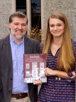 PHOTO PROVIDED Dr. Christopher Pearl and Maggie Slawson display the journal with their publication.