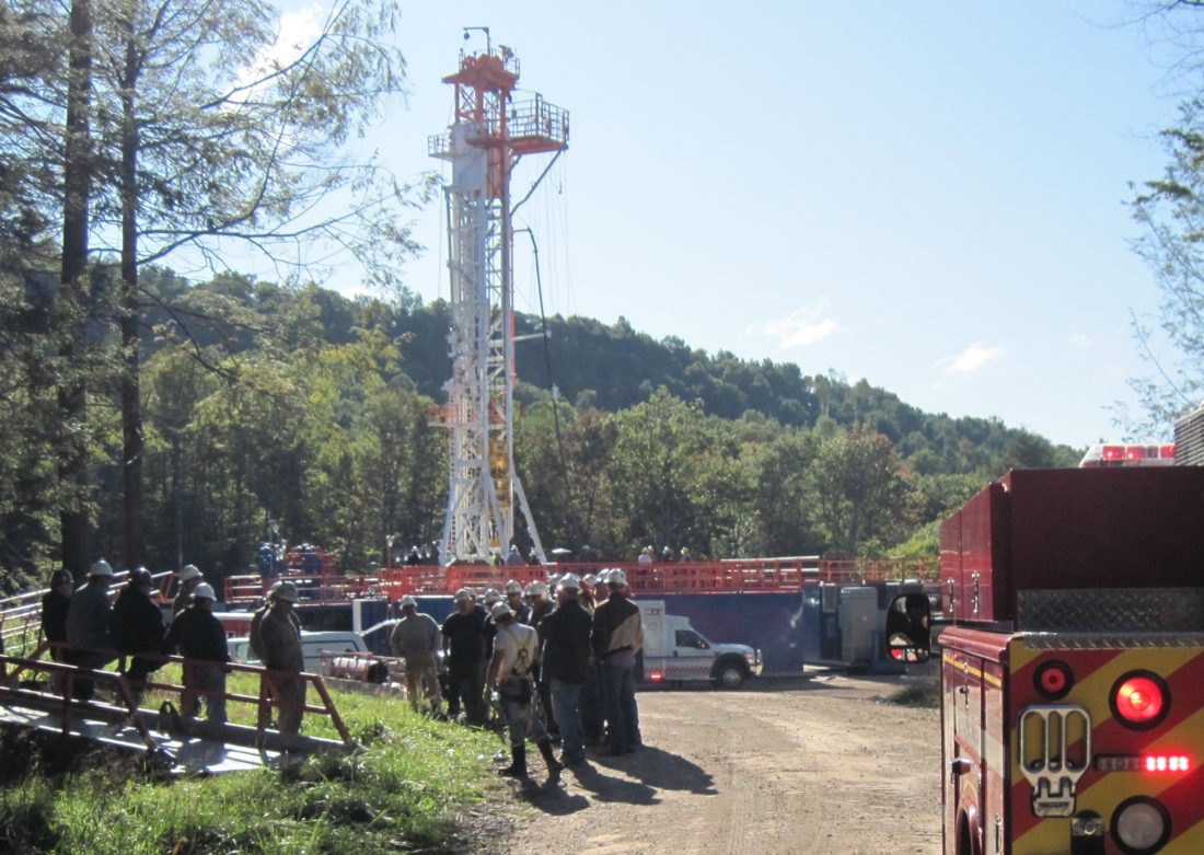 """SUN-GAZETTE FILEPHOTO Emergency crews arrive at a gas well site near Trout Run in late September, 2009, during an exercise designed to evaluate the ability of emergency agencies to respond to natural gas industry accidents. A """"victim"""" trapped in the gas drilling pipe at the left in the above photo. Gas well workers gather in a muster area, left photo, as emergency units arrive on the scene.  Municipalities in Lycoming County will get  $5.46 million in 2016 state impact fee money."""