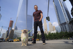 In this Wednesday, June 14, 2017 photo, Dion Leonard and his dog, Gobi, pose for a photo in New York. During a 155-mile race across the Gobi Desert, the dog sought out the the ultra-runner, who seems genuinely baffled by it all. He marvels at Gobi's ease crossing the Tian Shan mountain range and the distance she covered fending mostly for herself for food and water. (AP Photo/Patrick Sison)