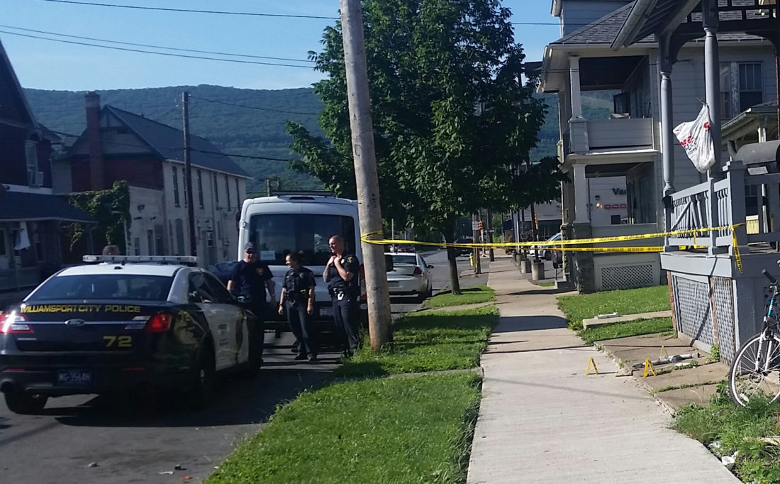 PHILIP A. HOLMES/Sun-Gazette City police work at a crime scene in the 300 block of Locust Street where a 36-year-old man was stabbed to death early Thursday morning. A male acquaintance was jailed Thursday night on homicide-related charges in connection with the death.