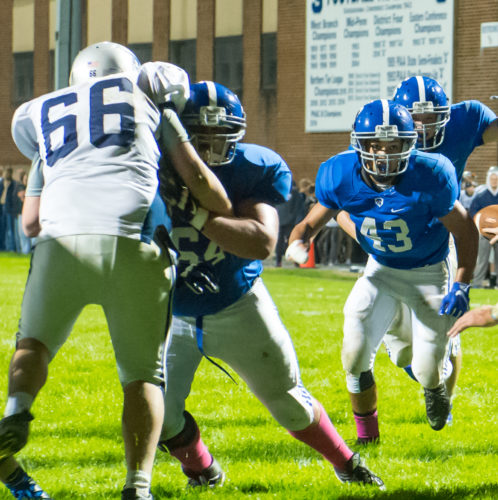 South Williamsport's Connor Rutan, left, blocks a defensive lineman during a game last year at South Williamsport. Rutan will play for the North all-star team in the District 4 game tonight. (SUN-GAZETTE FILE PHOTO)