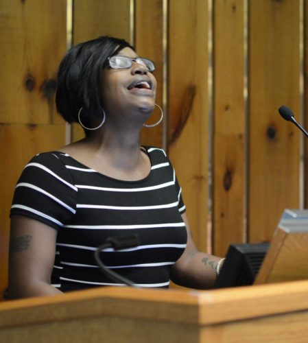 KATELYN HIBBARD/Sun-Gazette Tiffany Williams, of Williamsport, a former resident at Transitional Living Services Inc., tearfully sings about being a woman first as a thank-you to the staff of TLC, who she said showed her that she is more than the number she was given when she was incarcerated.