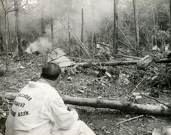SUN-GAZETTE FILE PHOTO An unidentified emergency responder takes in the scene of the Mohawk Airlines Flight 40 crash 50 years ago near Blossburg, Tioga County.