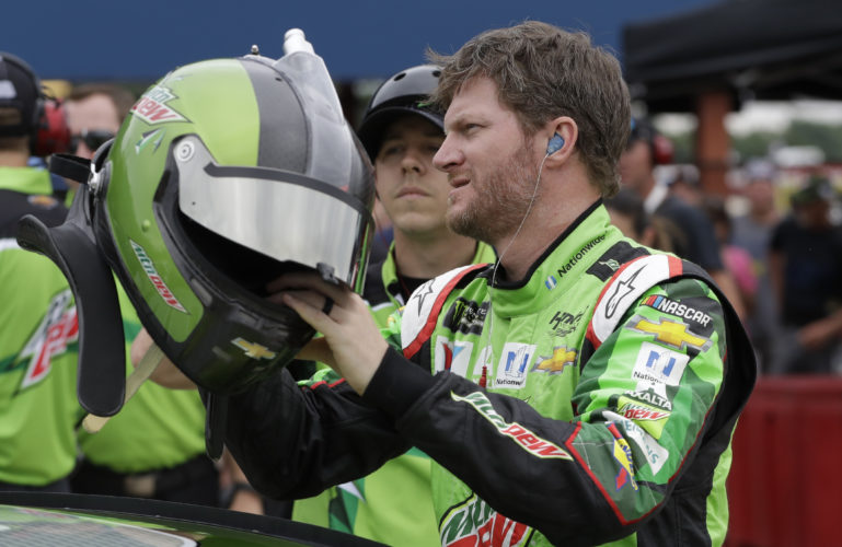 Dale Earnhardt Jr., reaches for his helmet before qualifying for a NASCAR Sprint Cup race in Brooklyn, Mich., in mid-June.  (AP)