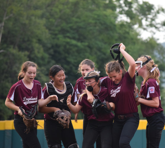 Members of the Loyalsock major softball all-star team celebrate with each other after defeatingClinton in the District 12 championship game at Volunteer Stadium on Thursday evening. (IOANNISPASHAKIS/Sun-Gazette)
