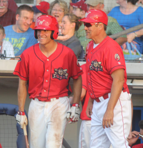 Williamsport Crosscutter Adam Haseley, left, smiles as he talks to manager Pat Borders prior to an at bat against the Batavia Muckdogs on Friday night at Bowman Field. (KAREN VIBERT-KENNEDY/Sun-Gazette)