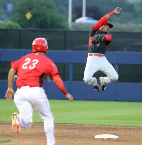The Williamsport Crosscutters' Gregori Rivero makes it safely to second base as the Batavia Muckdogs' Marcos Rivera reaches for the ball that went over his head on Friday night at Bowman Field. (KAREN VIBERT-KENNEDY/Sun-Gazette)