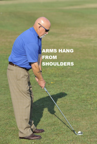 Allow the hands to hang down close to the body. (PHOTO PROVIDED)