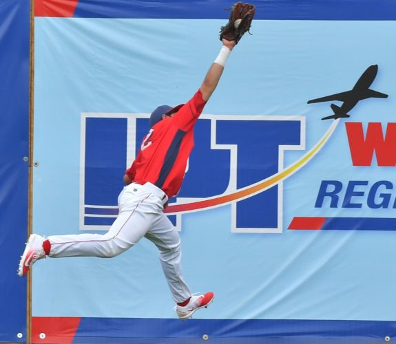 MARK NANCE/Sun-Gazette Josh Stephen chases down a fly ball Tuesday afternoon at Bowman Field.