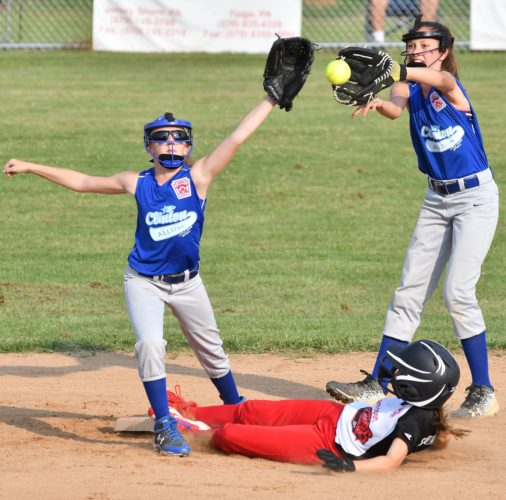 MARK NANCE/Sun-Gazette Williamsport's Kaelyn Sennett safely steals second base as Clinton shortstop Haleigh Peters, left, and second baseman Delaney Cohen try to field the throw in the first inning Tuesday at Oval.