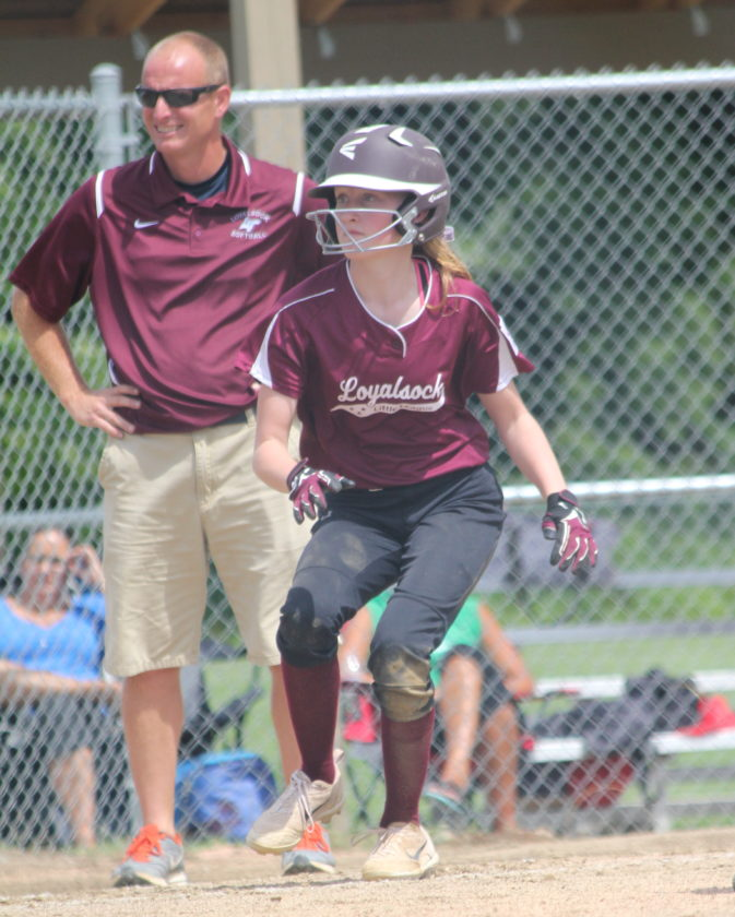 Loyalsock's Mallory Rodarmel reaches third as Loyalsock manager Joe Luxenberger looks on in the Major Softball state tournament.  Loyalsock beat Warrington, 13-1, to advance. (PHOTO PROVIDED)