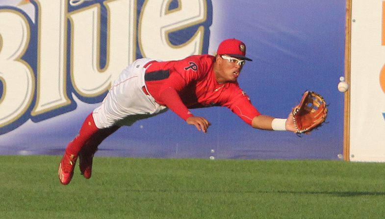 KAREN VIBERT-KENNEDY/Sun-Gazette Jhailyn Ortiz makes a diving catch Friday night for the Crosscutters against Lowell at Bowman Field.