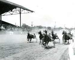 SUN-GAZETTE FILE PHOTO Horses close in to finish the race at the 1955 Lycoming County Fair.