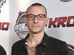 FILE - In this Dec. 13, 2014 file photo, Chester Bennington poses in the press room at the 25th annual KROQ Almost Acoustic Christmas in Inglewood, Calif. The Los Angeles County coroner says Bennington, who sold millions of albums with a unique mix of rock, hip-hop and rap, has died in his home near Los Angeles. He was 41. Coroner spokesman Brian Elias says they are investigating BenningtonÕs death as an apparent suicide but no additional details are available. (Photo by John Shearer/Invision/AP, File)