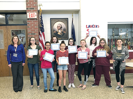 IOANNIS PASHAKIS/Sun-Gazette Shown are the top nine winners of the Loyalsock Township Middle School seventh-grade class who entered the Letters About Literature contest. Winners include Rylie French, Emma Ebersole, Mia Blas, Madison Kelleher, Emma Rude, Grace Baylor, Lily Wimer, Meghan Alvarez and Victoria Roman. Also shown, is their English teacher, Victoria Krout, far left.