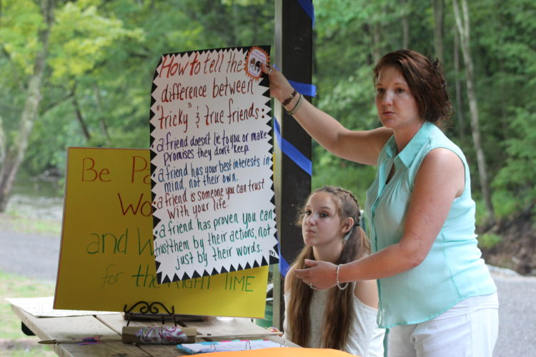 CARA MORNINGSTAR/Sun-Gazette Summer Love, Born2Fly teacher, speaks about sex trafficking education at a recent community meeting at James E. Short Park in Loyalsock Township. Sitting behind is Carrie Tassell, teen participant.