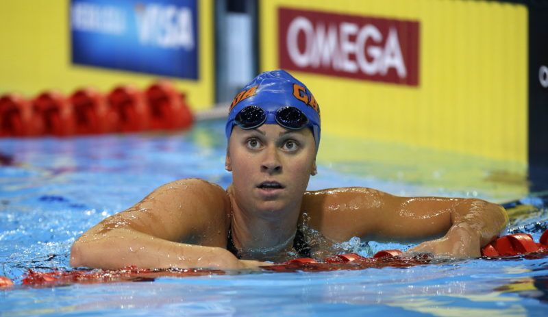 FILE -  In this Wednesday, June 27, 2012 file photo, Elizabeth Beisel swims in the women's 200-meter individual medley preliminaries at the U.S. Olympic swimming trials in Omaha, Neb. Matt Grevers and Elizabeth Beisel have been through this before. But they're still walking around the deck of the glittering Duna Arena in Budapest, Hungary looking a big wide-eyed, as if they can't quite believe they're here for another world championships, Saturday, July 22, 2017.  (AP Photo/Mark Humphrey, File)