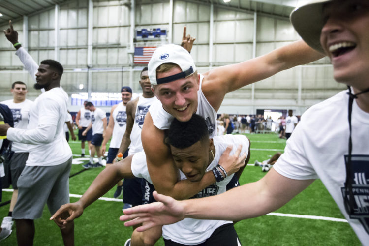 Penn State running back Saquon Barkley celebrates with quarterback Tommy Stevens during the Penn State Lift for Life last weekend in State college.